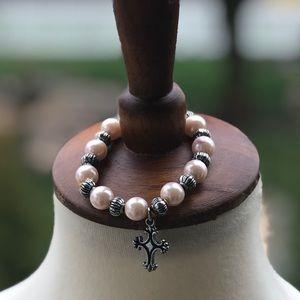 Vintage beaded bracelet with cross charm